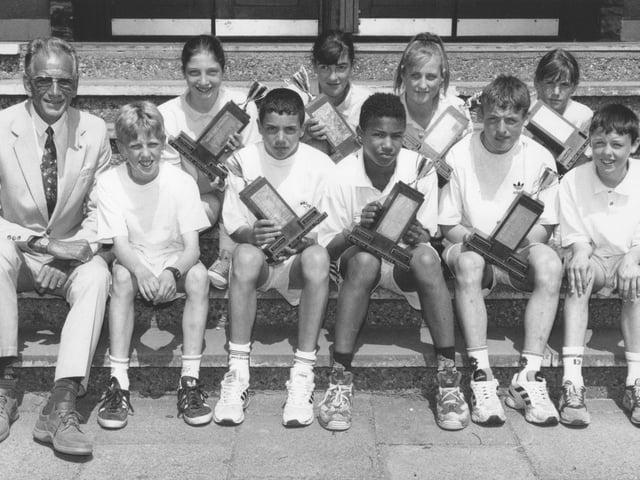 Graham School head teacher Milton Bowers, left, is pictured with school's sports day winners in June 1996. Back, J Black, J Pettitt, A Prince, S Webb; front, C Hill, A Connell, JJ Wilkinson, D O'Neill, C Dove.