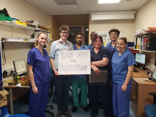 Dr See and some of his colleagues urging people to speak out against racism.