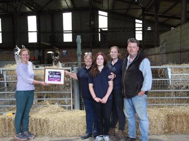 Playdale Farm Park family receive the Mumbler Award from Saraj Jane Barker