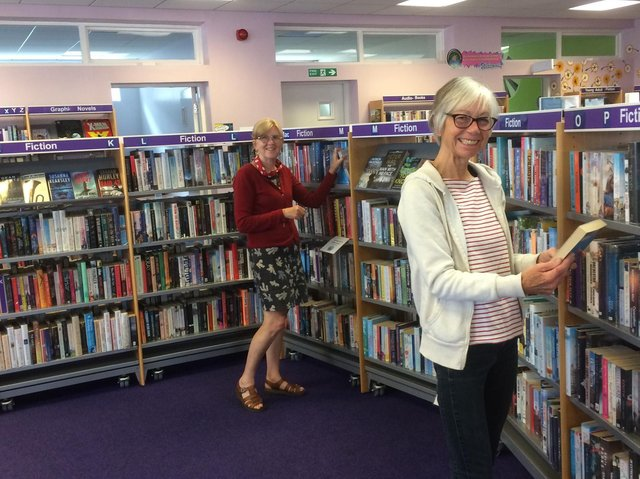 Library volunteers Jacqueline Byers (front) and Jane Pottas.