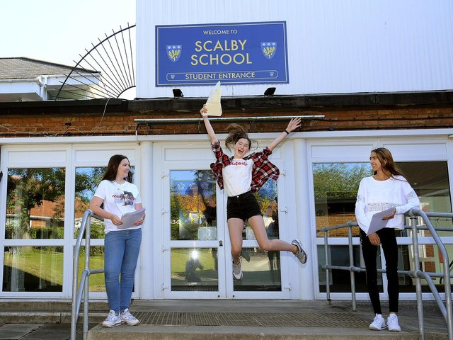 Ellie Palmer, Lily Roper and Sylvia Roca celebrate at Scalby School.