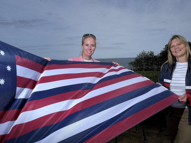 Fiona Clibbens and Kim Hodgson with the flag from the Bonhomme Richard.