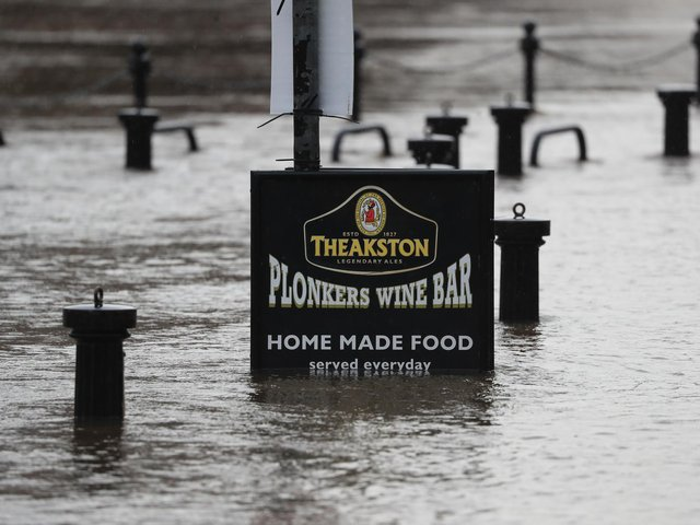 Flood water rises up a sign outside a pub in York as Storm Christoph is set to bring widespread flooding, gales and snow to parts of the UK. Photo: PA