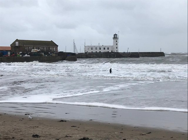 The man, in a wetsuit, was in the sea near the lifeboat station.
