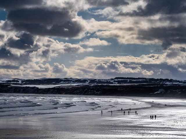 Members of the public brave the cold on Filey Beach.