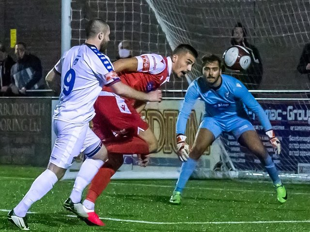 DERBY DELIGHT: Will Thornton fends off Whitby Town striker Brad Fewster during Boro's derby victory at the Flamingo Land Stadium