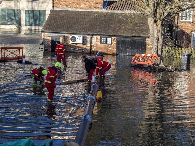 Fire crews pump out flood water in Malton back into the River Derwent.