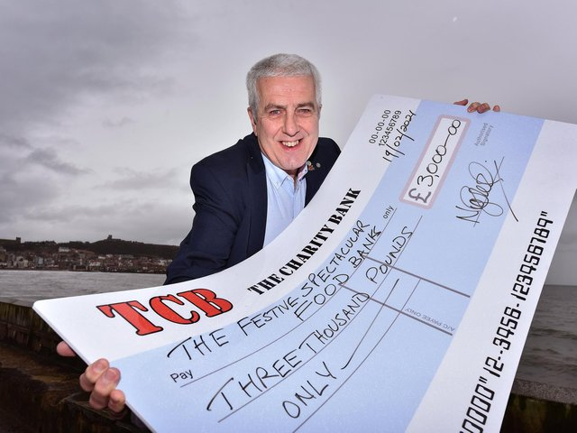 Organizer Nigel Wood presented the cheque to the charities.