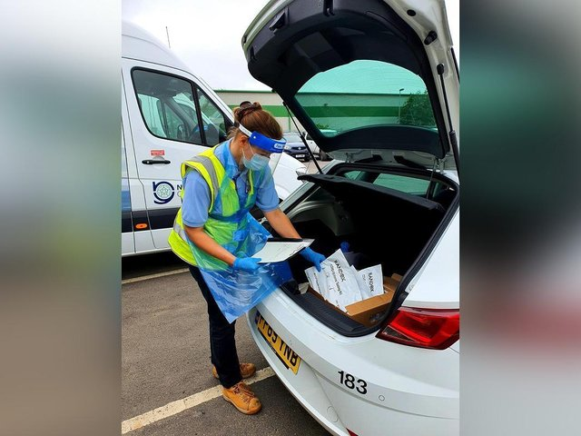 A county council driver prepares to deliver tests for a care sector satellite testing unit.