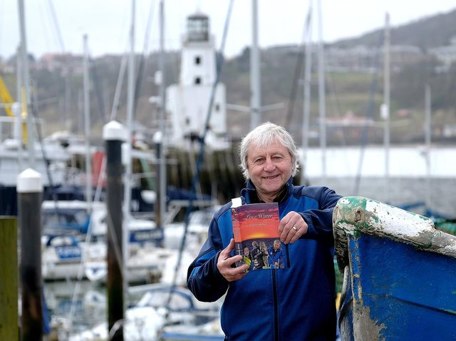 Fred Normandale with his latest book Low Water in Scarborough harbour. Picture: JPI Media/ Richard Ponter