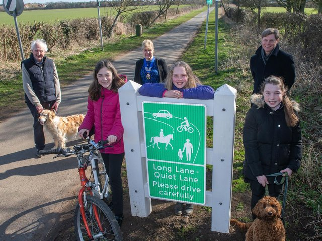 From left, County Councillor David Jeffels, Parish Council Chairman Councillor Lynda Wallis, Headteacher Jonathan Wanless with Seamer & Irton Community Primary School pupils from the same 'bubble' surrounding the Quiet Lane signage.