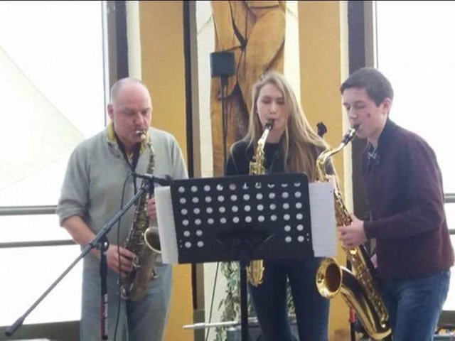 Bob Butterfield and Zak Parlby, who have done the work to create the jazz lunch video, with Maeve Sutterby in the centre.