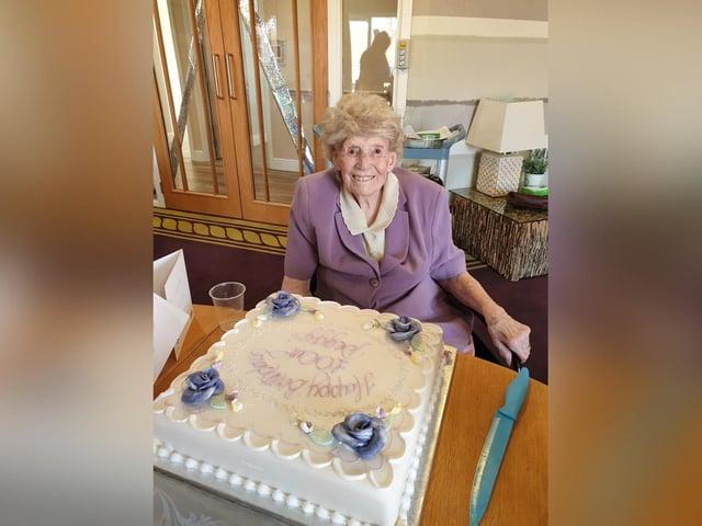Peggy Lambert with her 100th birthday cake