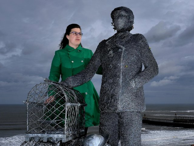 Zoe Taylor beside a statue from Emma Stothard to honour her great aunt Dora Walker. The Whitby Civic Society is now to dedicate a blue plaque to Whitby's first female skipper. Image by Richard Ponter.
