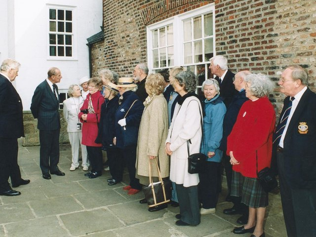 Prince Philip meets guests in the grounds of the Captain Cook Museum.