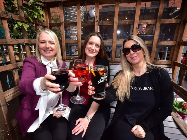 Cheers! Lindsay Falcus, Rachael Boorer and Lisa Prince share drinks at The Courtyard.