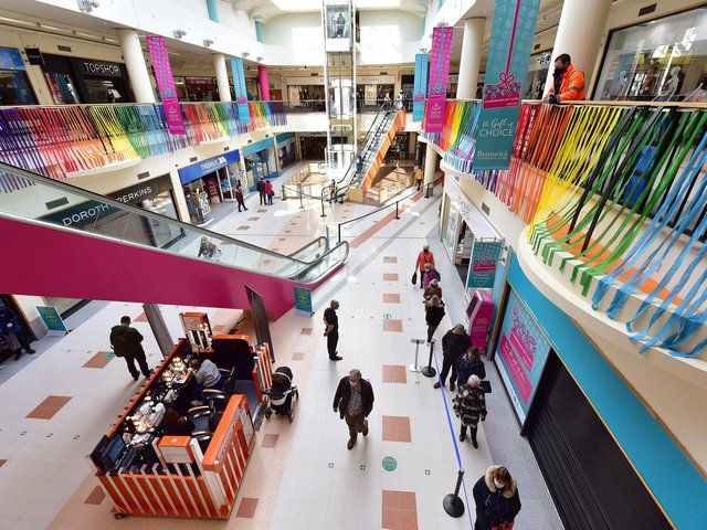 Colourful streamers decorate the Brunswick Shopping Centre as customers returned.