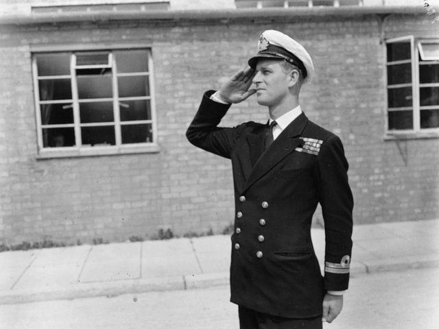 Lieutenant Philip Mountbatten, prior to his marriage to Princess Elizabeth, saluting as he resumes his attendance at the Royal Naval Officers School at Kingsmoor, Hawthorn, England, July 31st 1947. (Photo: Keystone/Getty)