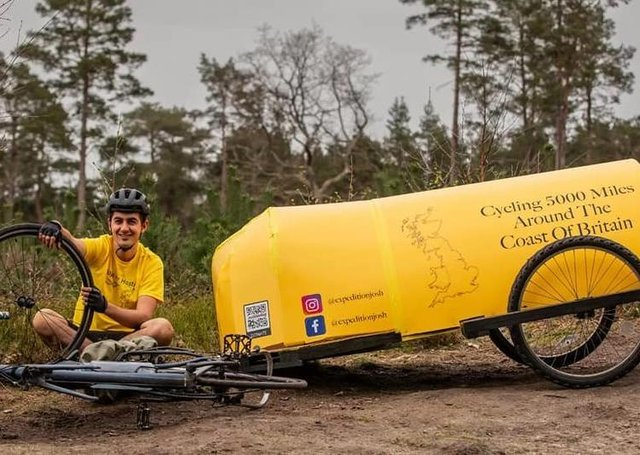 Josh Garman, 22, is towing a yellow, home-made bicycle camper behind him which he will sleep in as he tackles a five-month, 5,000 mile solo cycle for charity.
