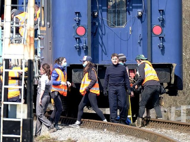 Tom Cruise prepares for an action scene at Levisham Station.