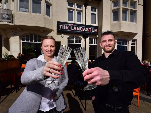 Managers Lelde Caune and Ray Clarkson make a toast to the big opening day.