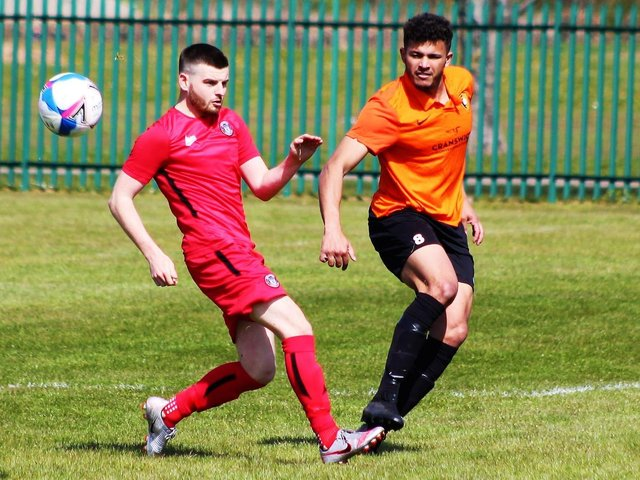 COUNTY CLASH: Lloyd Henderson is put under pressure by a Boro Rangers opponent during Saturday's North Riding FA County Cup quarter-final clash. Picture: Alec Coulson
