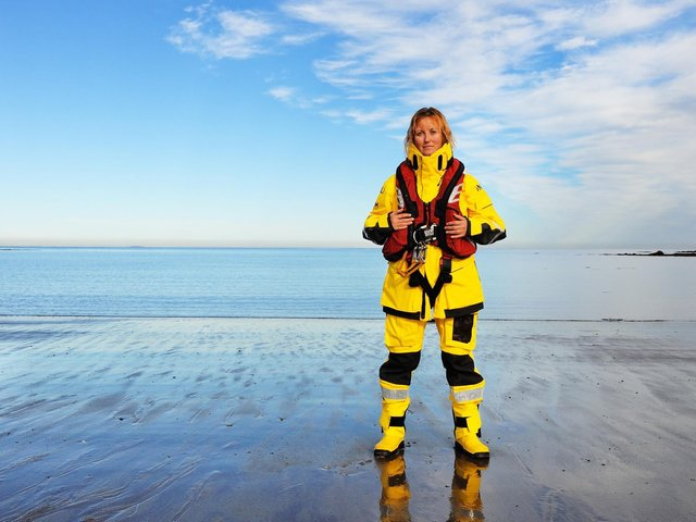 Image of RNLI volunteer Becs Miller issued by charity as it reveals rising number of rescues carried out last summer