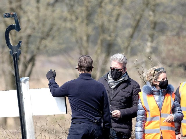 Director Christopher McQuarrie was pictured chatting on set with Tom Cruise.