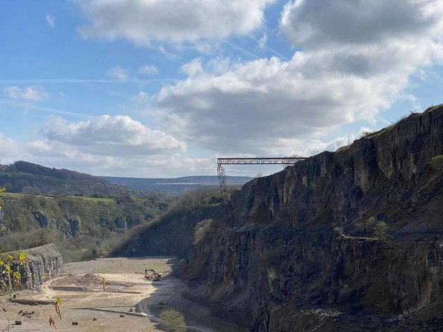 A huge bridge has been constructed over the edge of a disused quarry in Derbyshire.