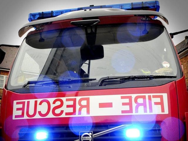 Four fire crews tackled the muck heap blaze.