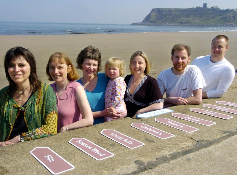 Getting ready for the Arts Festival launch, from left, Claudia Nye, Kate Evans, Dorcas Taylor with two year old Rosa, Wendy Clews, Anthony Springall, and James Rush.