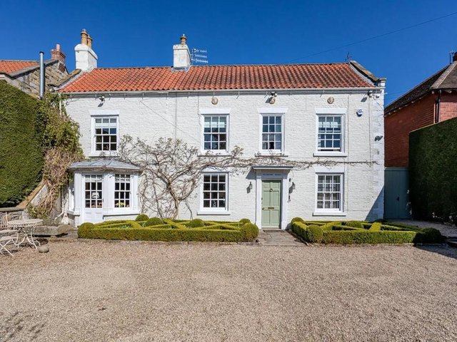 This Scalby home, converted from a Georgian house and a coach house, is highly individual, with lovely gardens.