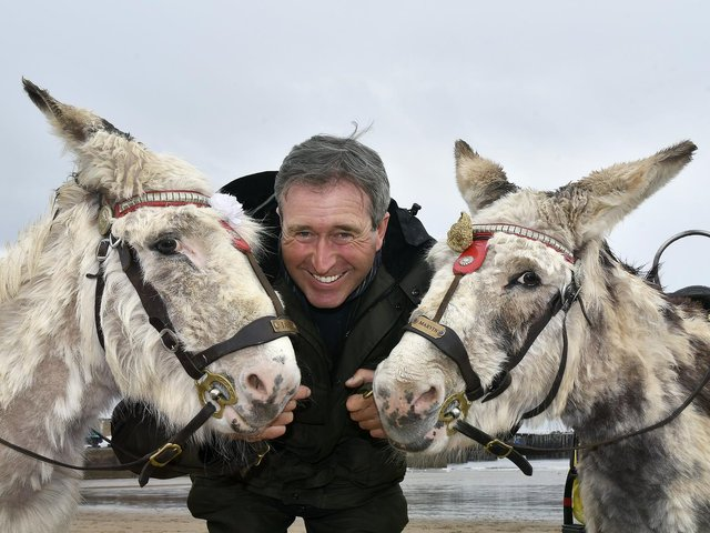 Guy Smith and his donkeys on South Bay beach.