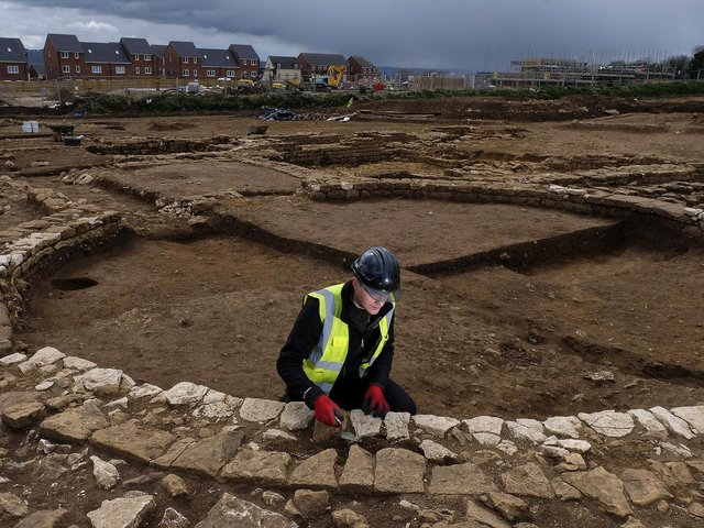 Trainee Field Archaeologist Corey Greening works on the site.