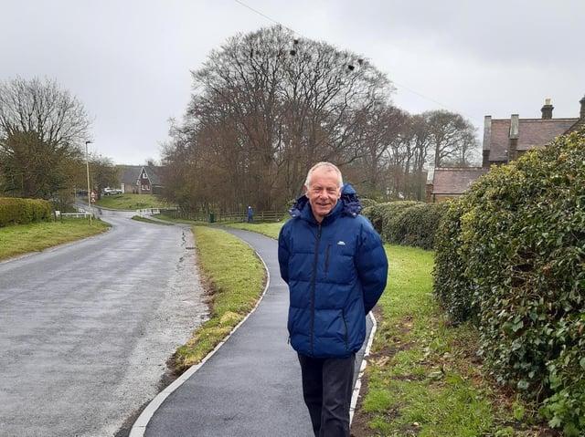 Cllr Derek Bastiman standing on the new path.