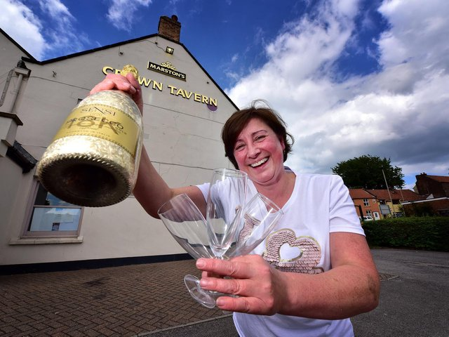 Belinda Leppington at the Crown Tavern, pictured celebrating when pubs were allowed to reopen after lockdown in June 2020.