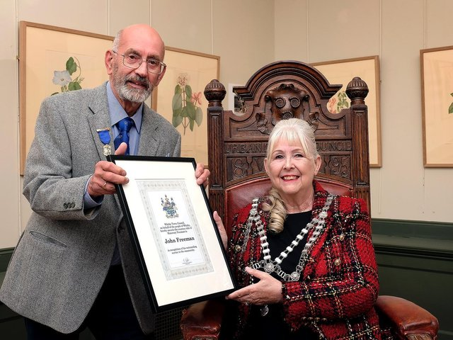 John Freeman receives his Honorary Freeman award from the Mayor of Whitby, Cllr Linda Wild.