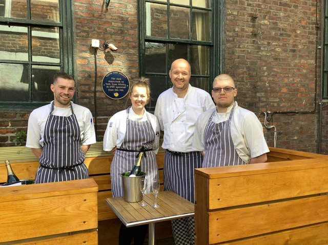 L-R: Robert Kirton Hudson, Commis Chef (from Bramblewick), Megan Hopper - Sous Chef (White Horse & Griffin team), Michael Coates, head chef and formerly of Bramblewick and Tom Locker, Sous Chef (from Bramblewick) toast to new beginnings.     Not in photo - Finn O'Leary – Kitchen Porter (from Bramblewick) also joins the WH&G team.