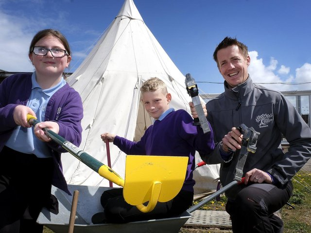 Pupils Krystal and Kyran work on the new eco garden, with staff member James Armstrong.