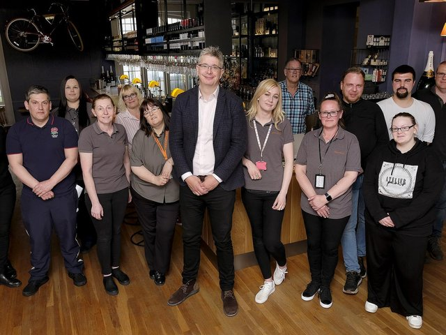 General Manager Jay Clements (centre) with the team at the Bike and Boot Hotel.
