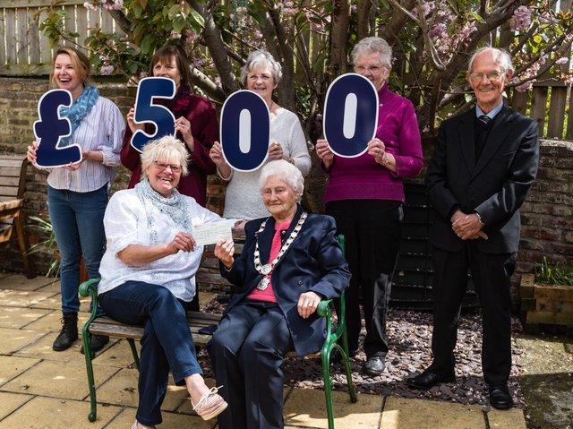 The Rainbow Centre's Trish Kinsella (front, left) receives a cheque for £500 from The Vale of York Oddfellows