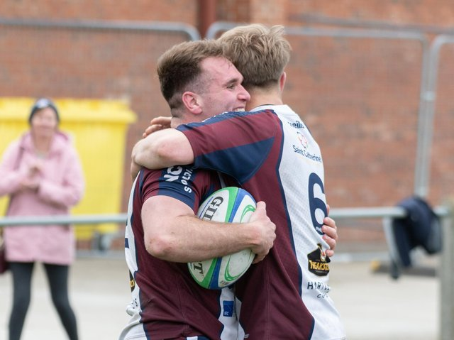 Aaron Thompson celebrates scoring the levelling try for the hosts  PHOTOS BY ANDY STANDING