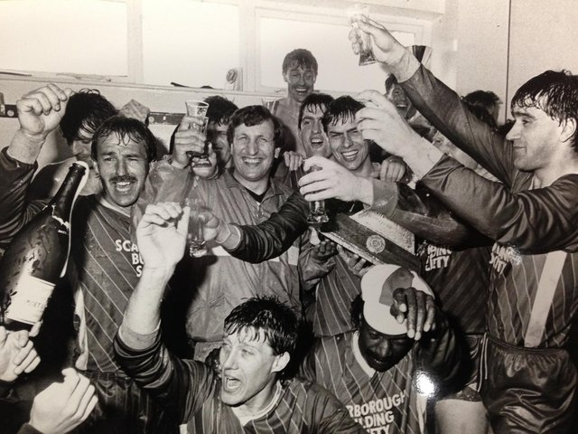 Scarborough FC legend Mitch Cook, pictured centre, celebrating Boro's promotion to the Football League.