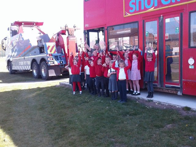 Children celebrate the bus arriving at school. Picture: EBOR Academy Trust