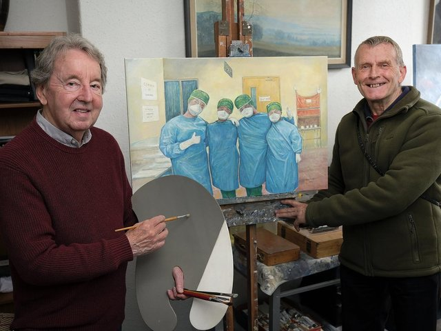 Mr Stuttle and Mr Grice with the original painting of the three nurses.