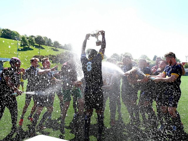 Angel's champagne celebrations after their final win over Trafalgar.  Photo by Richard Ponter.