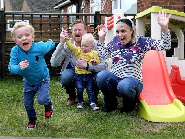 Archie Cook completes his fundraising garden laps with dad Nick, sister Izzy and mum Claire cheering him on.