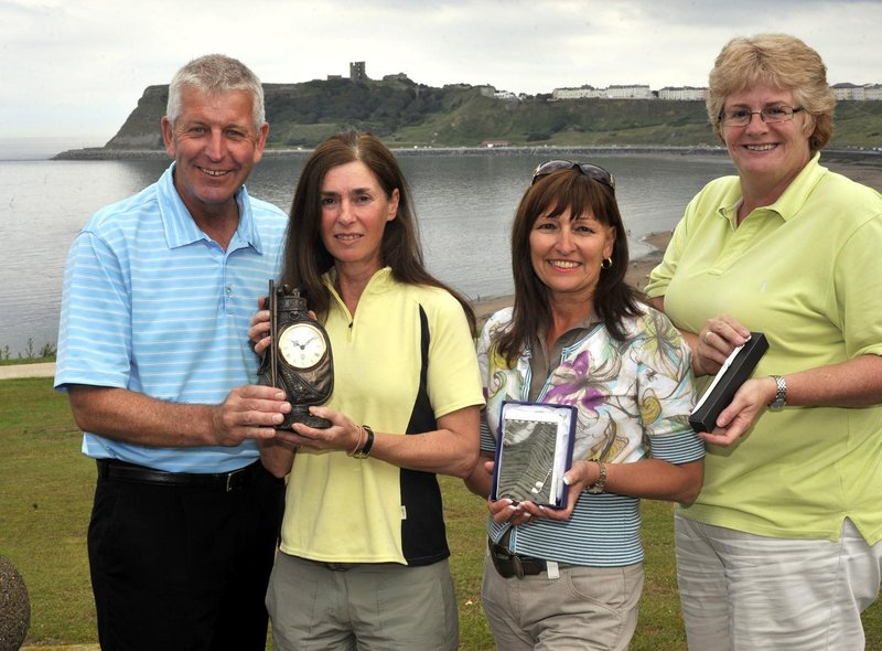 Simon Deller presents awards to North Cliff lady golfers Janet Brown, Debbie Haith and Alison Lockwood.