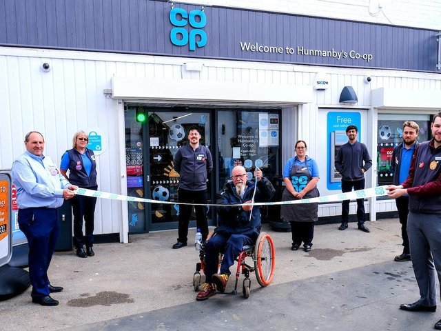 Local resident and customer Andy Hunter performs the ribbon cutting at Hunmanby Co-op. With staff, from left, Mark Ross, Kirstie Brignall,Nicholas Moorwood, Shelley Ross, Alex Groom, Connor Brignall, Steven Padley.