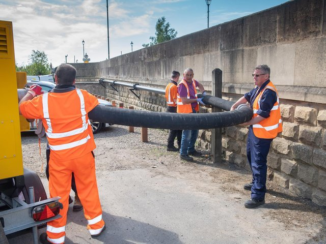 A crew sets up one of two new quiet pumps bought as part of the scheme.